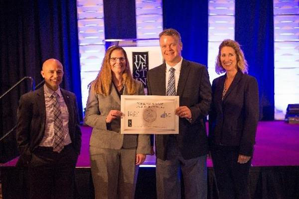 Kimball International.Top 10 Public Companies. L-R Mitchell DePoy of the CFA Society, Michelle Schroeder and Dennis Gerber of Kimball International, and Beth Taylor of FEI