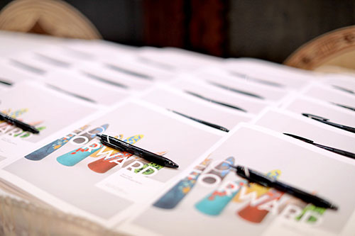 The workbooks lined up for participants to rate the new products.